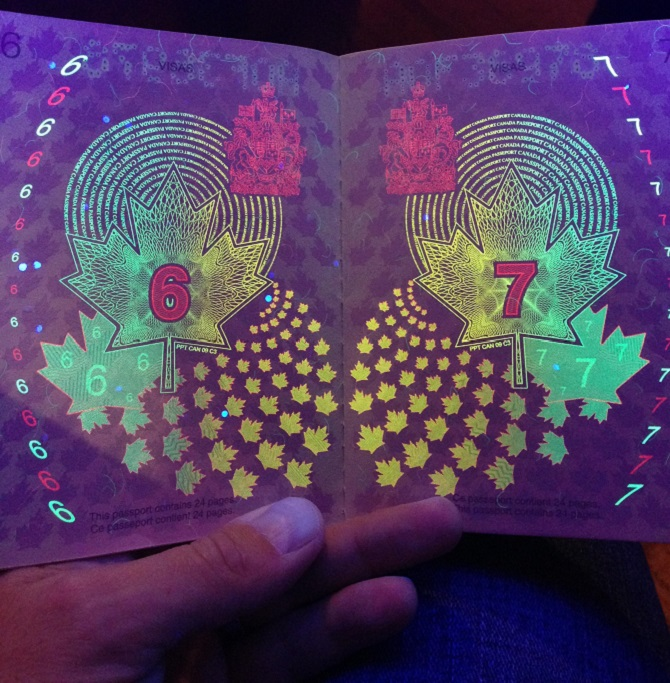 Old Canadian Passport with black light
