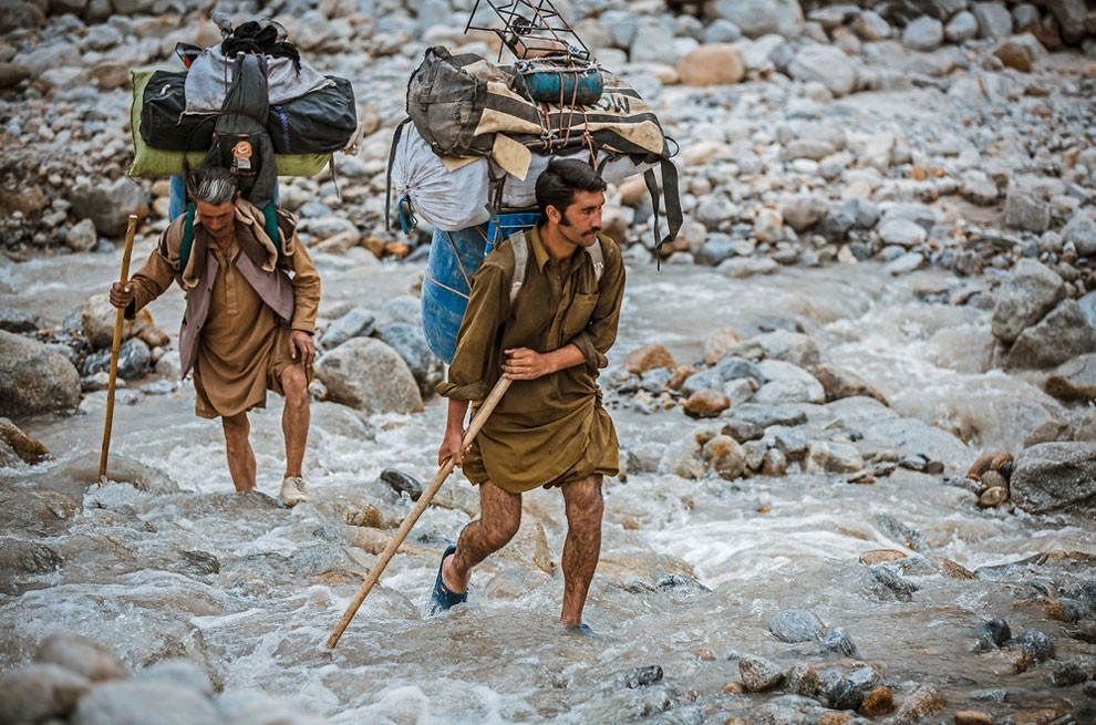 Balti porters carrying loads which range from 25kg to 50kg, a task they undertake often wearing only basic rubber sneakers filled with fresh grass to stop their feet slipping.