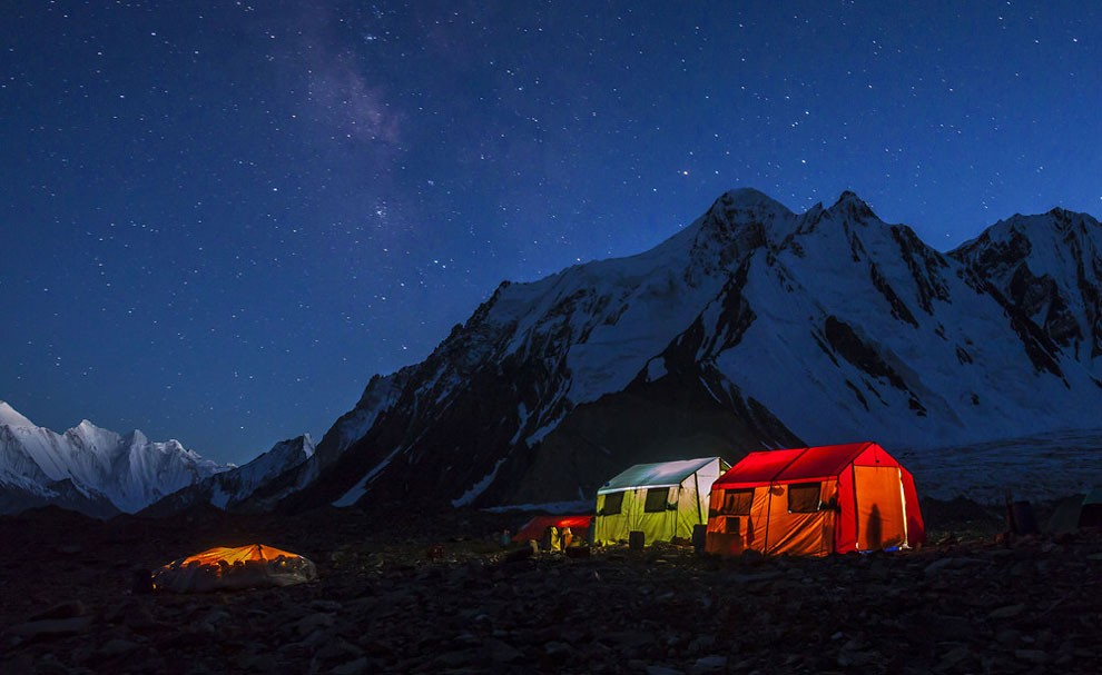 The porters' tent at K2's base camp is just a tarpaulin stretched over the stones, left, while the other tents belong to expedition members.