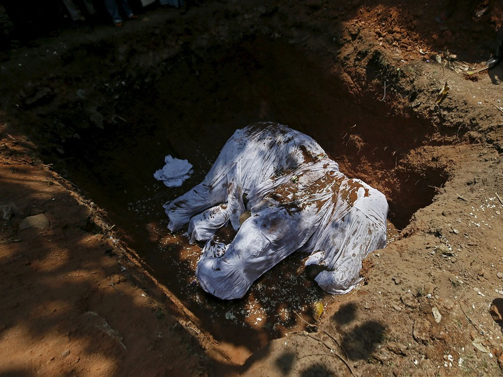 A covered dead body of elephant Hemantha is seen during a religious ceremony at a Buddhist temple in