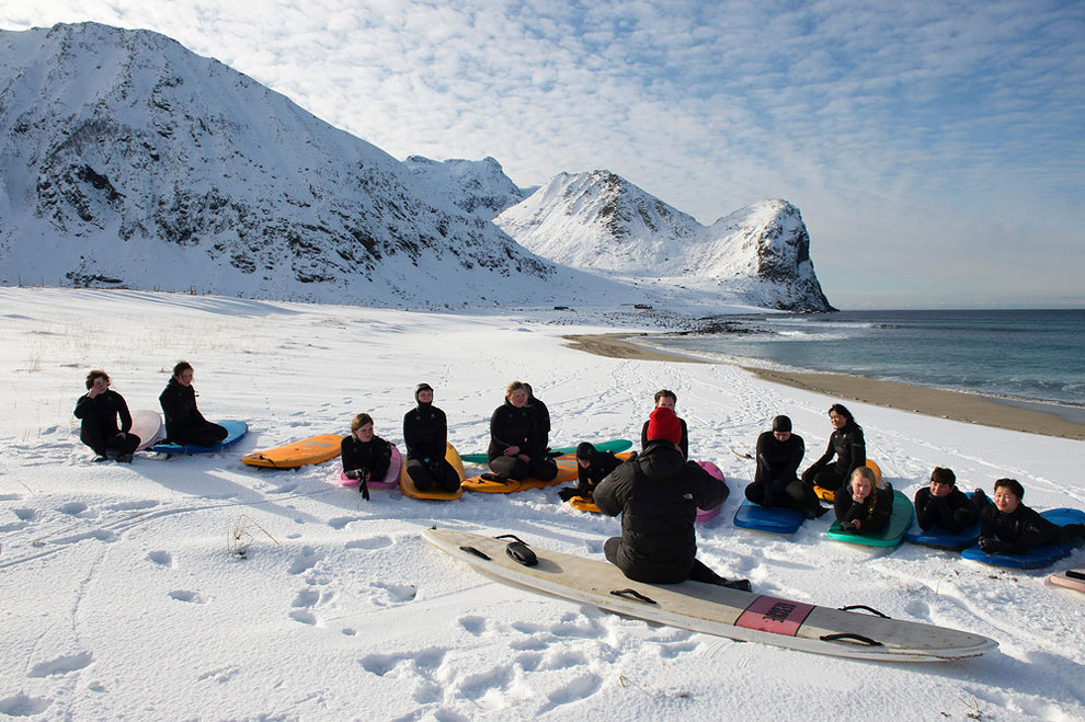 A group of beginner surfers from Norway attend their 1st course at snowy beach of Unstad, Norway on Lofoten Island, Arctic Circle, on March 9, 2016.