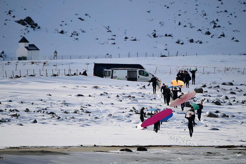 A group of beginner surfers from Norway attend their 1st course at snowy beach of Unstad