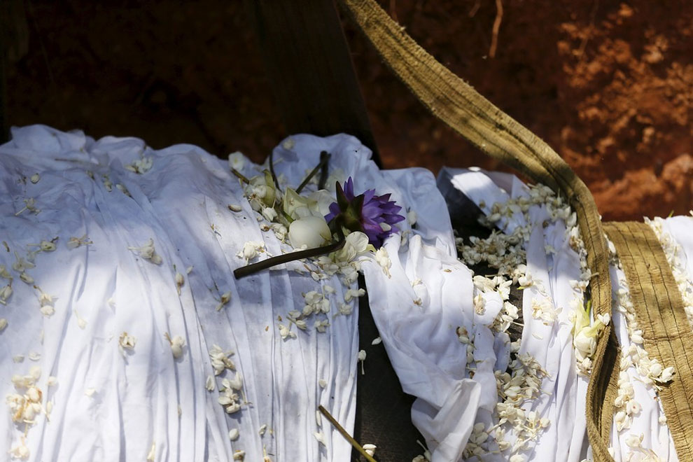 Flowers offered by local villagers seen on the dead body of elephant Hemantha is seen during a religious ceremony at a Buddhist temple in Colombo March 15, 2016