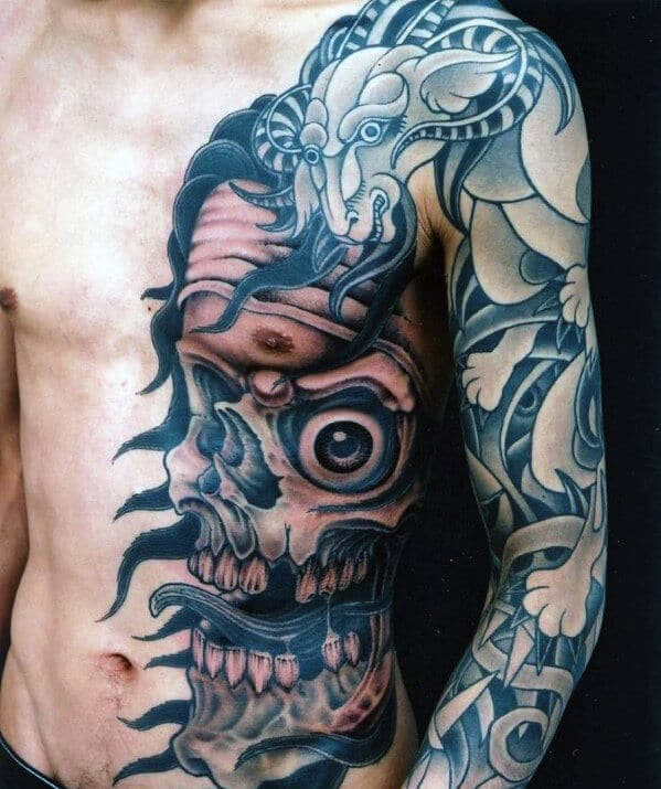 skull-and-dragon-mens-chest-tattoo