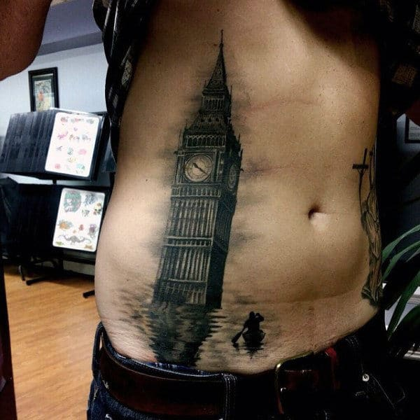 clock-tower-guys-stomach-tattoos-with-realistic-water-and-boat