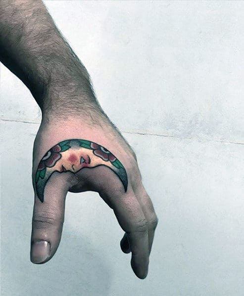 mens-traditional-half-moon-side-of-hand-tattoo