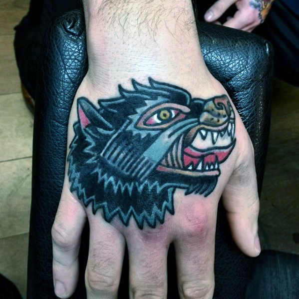 traditional-wolf-male-hand-tattoos