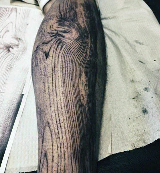woodgrain-leg-tribal-tattoos