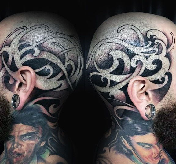 cool-negative-space-tribal-head-tattoos