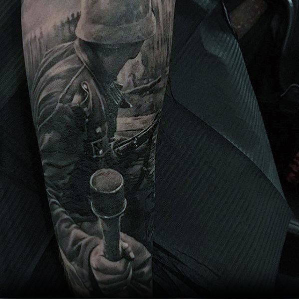 gentleman-with-hyper-realistic-war-sleeve-tattoo