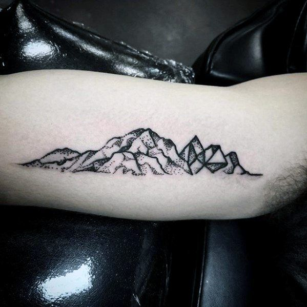 inner-arm-bicep-mountains-small-unique-tattoos-for-guys