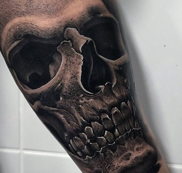 inner-arm-male-hyper-realistic-skull-tattoo