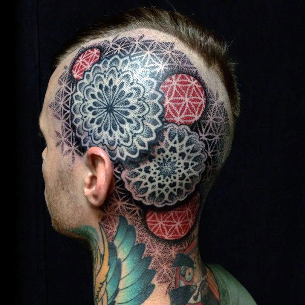 man-with-geometric-red-and-black-ink-head-tattoos