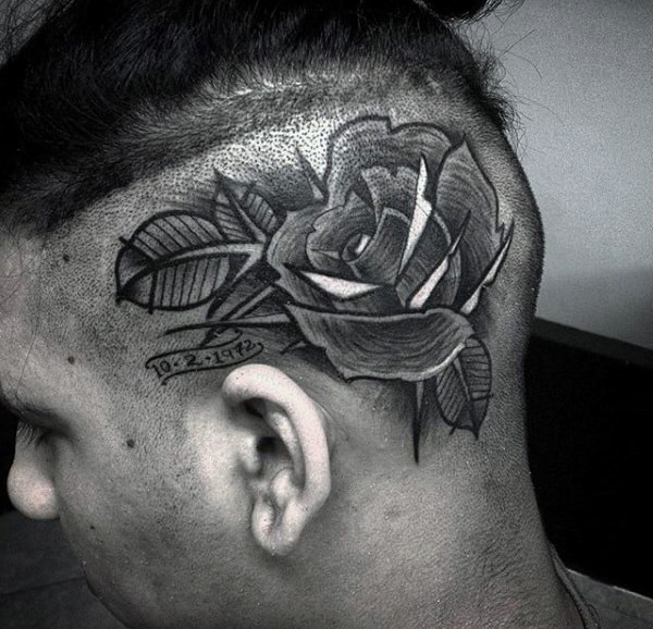 man-with-rose-flower-head-tattoo