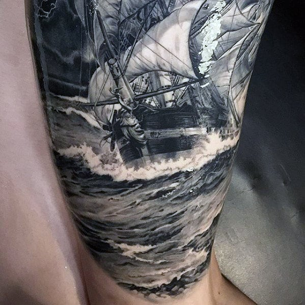 mens-hyper-realistic-boat-sailing-on-ocean-waves-sleeve-tattoo