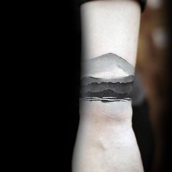 mountains-watercolor-black-and-grey-male-small-unique-wrist-tattoo-ideas