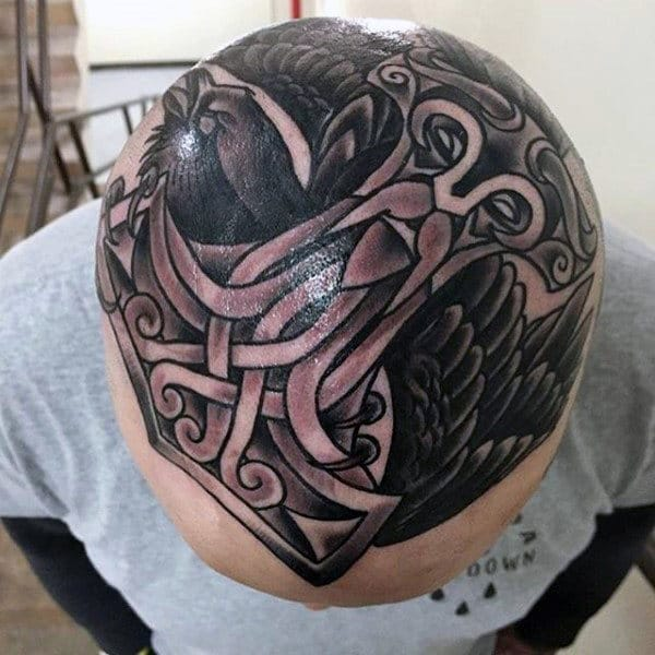 thor-hammer-guys-head-tattoo-with-black-crow