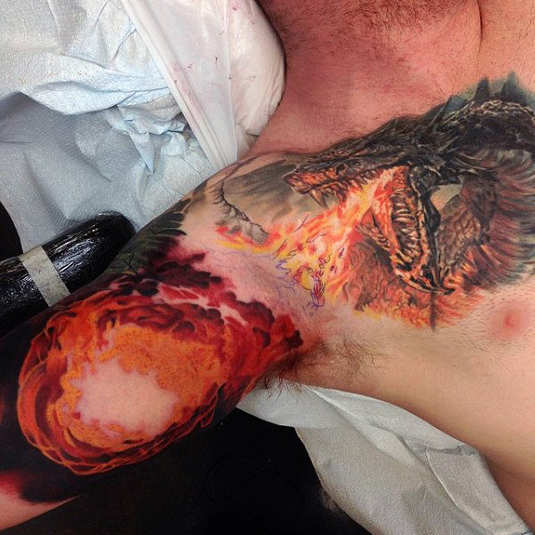 dragon-breathing-fireball-mens-chest-and-inner-arm-tattoos
