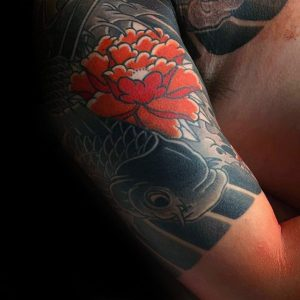 red-japanese-flower-with-koi-fish-mens-quarter-sleeve-tattoo