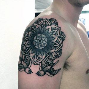 male-arms-pair-of-birds-and-floral-dotwork-tattoo