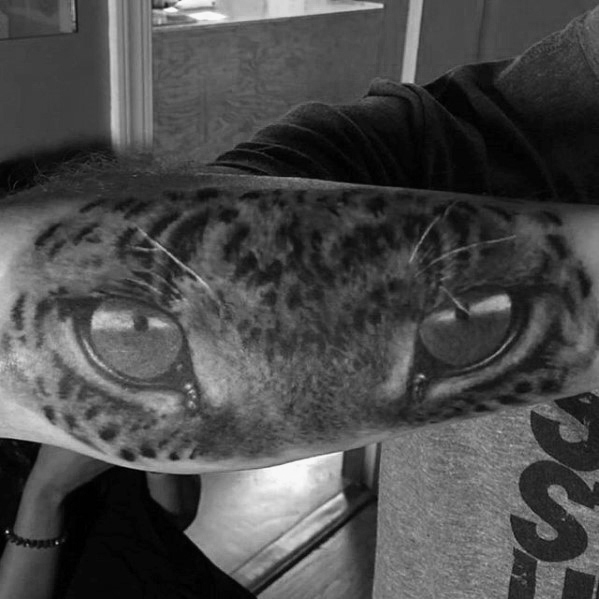amazing-cheetah-eyes-male-outer-forearm-tattoos