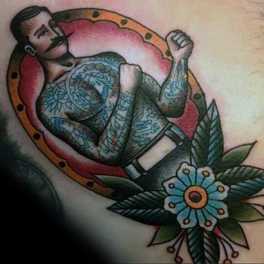 frame-boxer-with-blue-flower-traditional-mens-back-tattoos