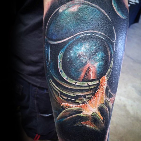 diver-with-glowing-star-fish-3d-forearm-sleeve-tattoo-on-men