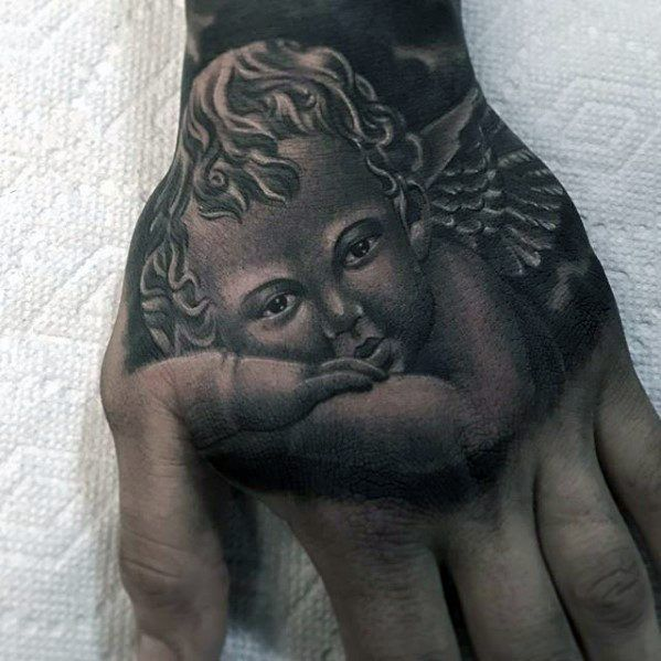 angel-hand-guys-tattoo-cover-up-ideas