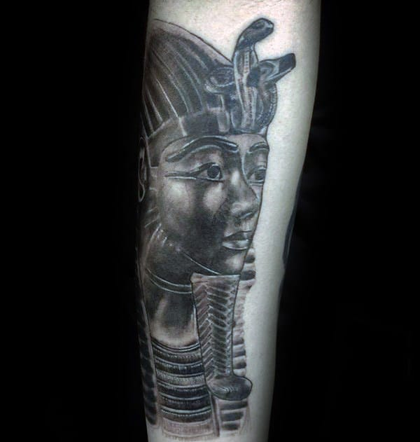 guy-with-king-tutankhamun-tattoo-on-forearm-with-black-and-grey-shaded-ink-design