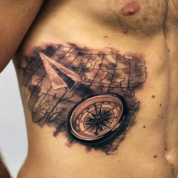 paper-airplane-world-map-ribs-tattoo-for-men