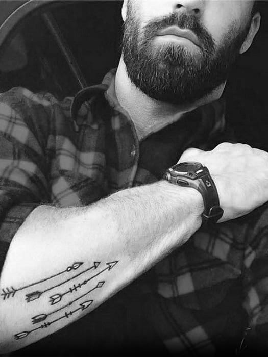 guys-tattoos-with-small-arrow-design-outer-forearm