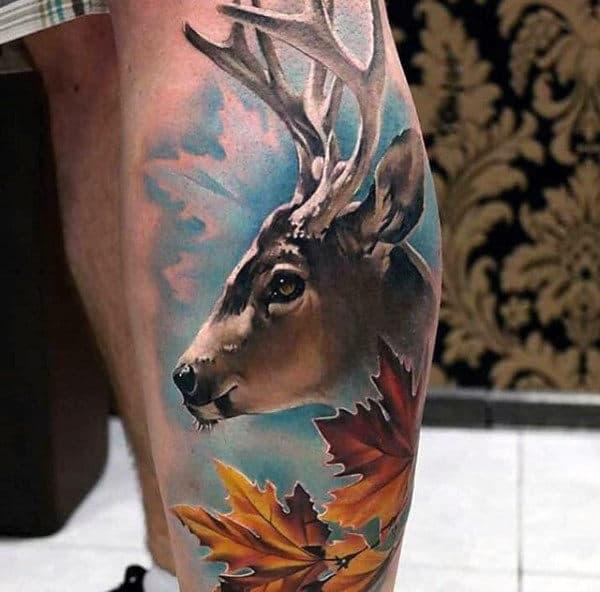 full-color-mens-leg-calf-deer-tattoo-with-blue-sky-and-orange-leaves